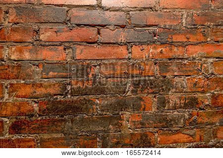 Old wall of stone gray, black and red bricks textured background