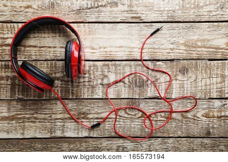 Headphones on a grey wooden table, close up