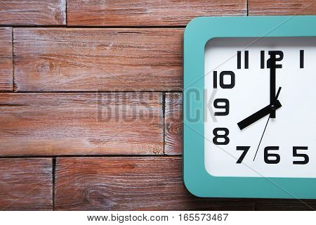 Green Clock On A Brown Wooden Table