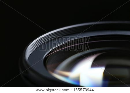 Camera Lens on the black background, close up
