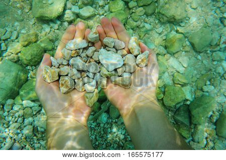 Female Hands With Pebbles