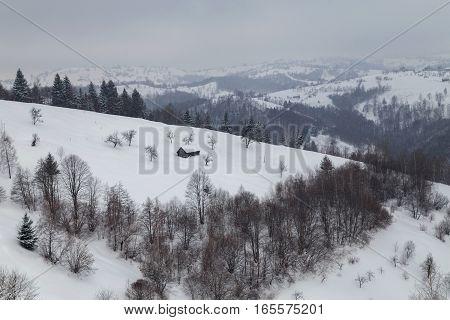 Beautiful mountain road in winter, in Transylvania poster