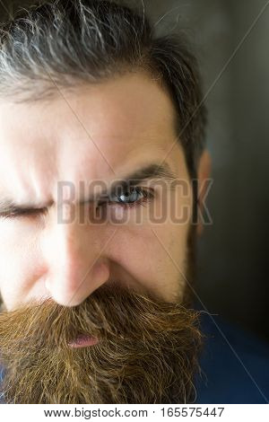 young handsome bearded man portrait with hipster beard and mustache on serious face