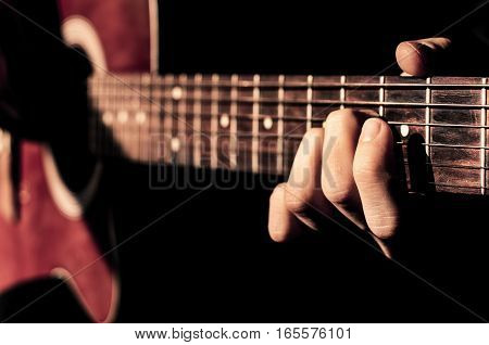 Young man playing guitar. Music instrument education entertainment rock star music concert and learning concept