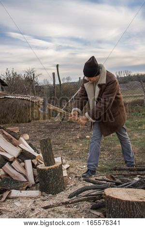 a man chopping wood in the village.