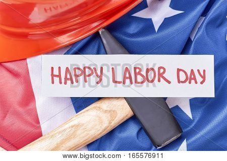 Hammer on american flag background. Happy Labor Day congratulation. Actions speak louder than words.