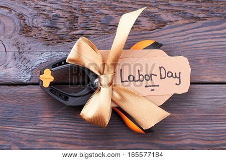 Plastic clamp with ribbon bow. Clamp and Labor Day card. Work of imagination.