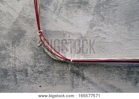 Close-up of electric wires installed on grunge wall