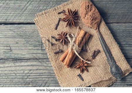Cinnamon, Cocoa, Anise And Cloves On Wooden Table