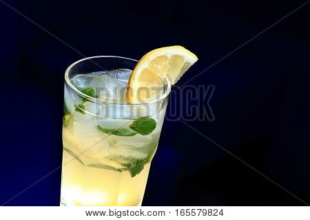 Glass Of Lemonade With The Slice Of Lemon And Mint. Dark Background
