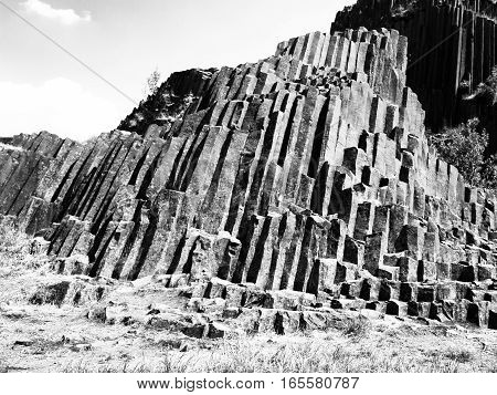 Unique basalt organ pipes rock formation of Panska skala near Kamenicky Senov in Northern Bohemia, Czech Republic, Europe. Black and white image.