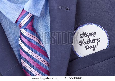 Father's card in suit pocket. Blue shirt and necktie. Stylish look for dad.