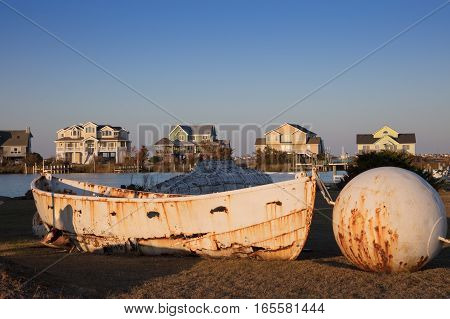 Old boat and houses at Nags Head North Carolina