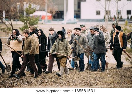 Gomel, Belarus - November 26, 2016:Actors dressed as civilians at Soviet territory under Nazis occupation during World War II. Celebration of 73rd anniversary of liberation of Gomel from Nazi Invaders
