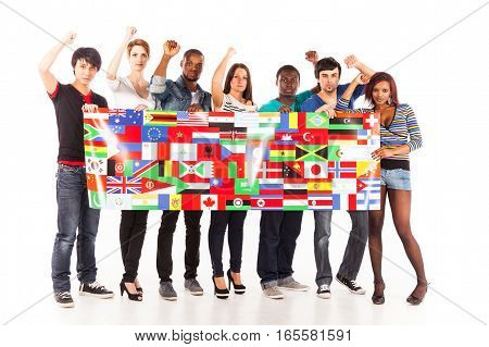 multi-ethnic group of young adults. image shows public-domain flags from the CIA world factbook.