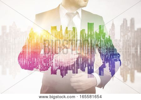 Businessman on abstract rainbow city background. Double exposure