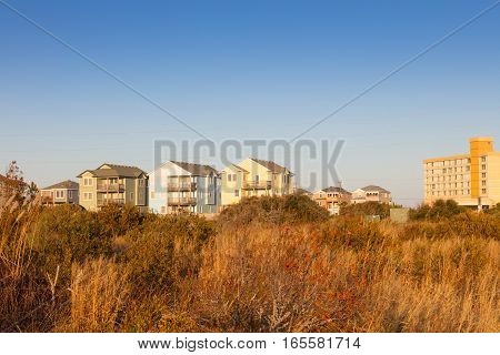 A row of rental houses and hotel on Cape Hatteras National Seashore North Carolina