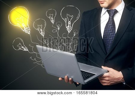 businessman standing with laptop. idea concept. Close up.