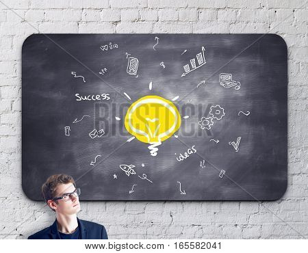 businessman thinking and drawing financial sketch on blackboard
