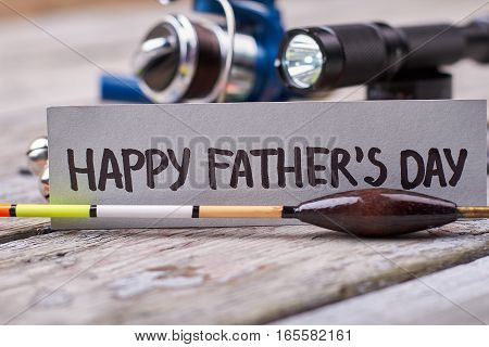 Bobber and Father's Day card. Torch and greeting paper. Art of fishing.