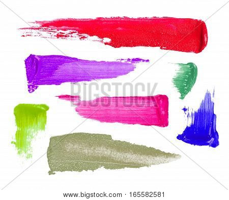colorful cosmetic strokes closeup on white background