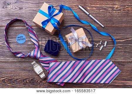 Tie and watch for father. Greeting card and pen. Classic accessories as gift.