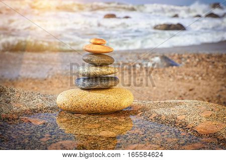 Zen Balancing Pebbles On Beach