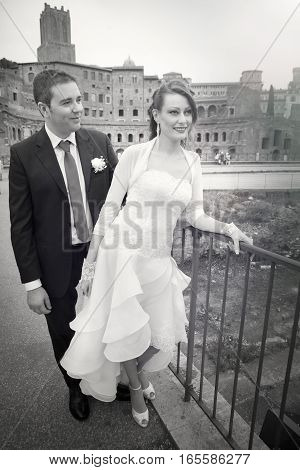 Husband and wife. Couple marriage. Newlyweds. Black and white. The two married are located in the historic center of Rome, close to the Imperial Forums. Black and white