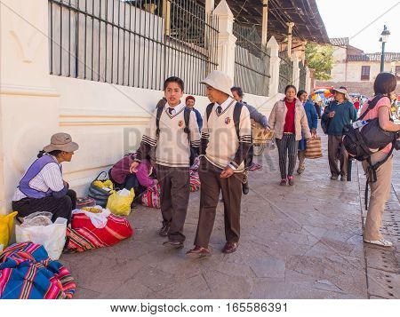 Cusco Peru - May 27 2016: Children from the school wearing the uniforms walking on the street of the Cusco