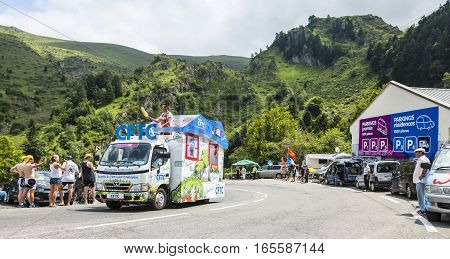 Col du Tourmalet, France - July 24,2014: CFTC caravan during the passing of the Publicity Caravan on the road to Col de Tourmalet in the stage 18 of Le Tour de France 2014.