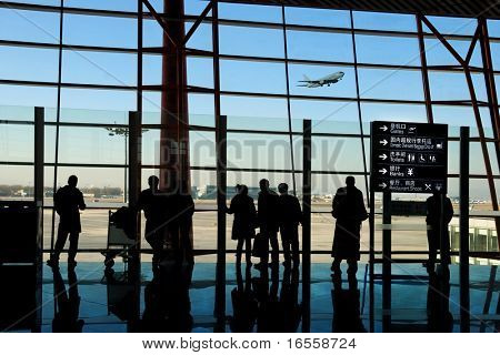 poster of travelers silhouettes at airport