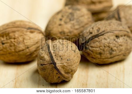 Nuts On A Pine Wood Background.