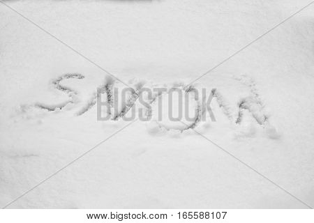 close up on Word snow written in snow
