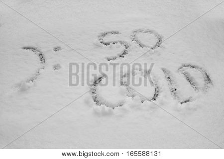 close up on Word so cold written in snow