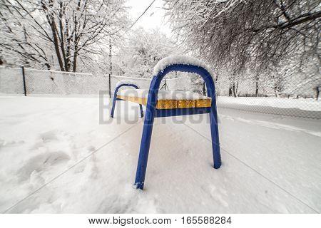 Bench Under Snow In Winter