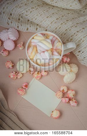 Good morning with hot chocolate on wooden table with love blank card for valentines day concept, top view