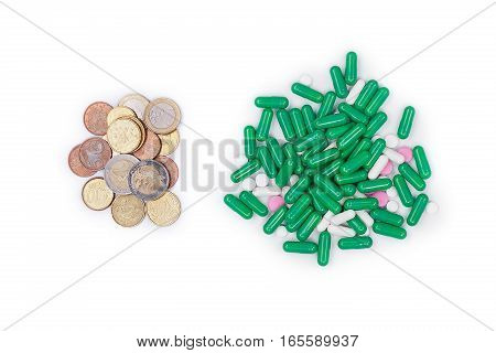 Money next with pills on white background. The cost of the pills .