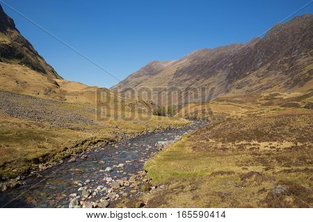 River Clachaig Glencoe Scotland UK Scottish country scene in Scottish Highlands in spring