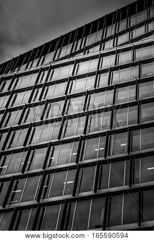 Modern glass and steel facade of a commercial building in London, UK