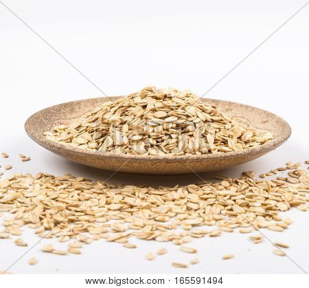 Healthy food oats for oatmeal in a wooden bowl