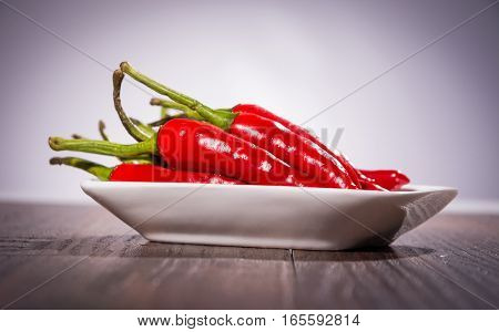 cayenne chili peppers on a plate .