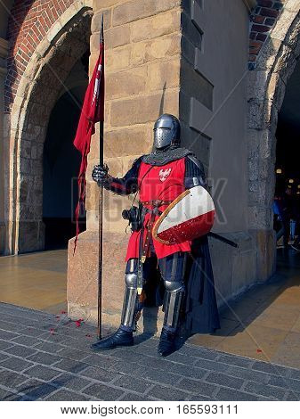 Knight Polish Krakow. Krakow, Poland - November 05, 2016 Medieval knight with Polish Cloth Hall in Krakow.