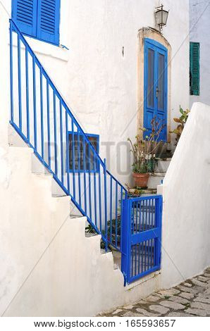 White and blue street view in the city of Ostuni Italy Europe