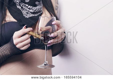 Woman With A Glass Of Red Wine And A Cigar.