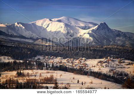 Winter Tatra mountains and Jurgow village in sunset light Poland