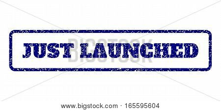 Navy Blue rubber seal stamp with Just Launched text. Vector caption inside rounded rectangular shape. Grunge design and dirty texture for watermark labels. Horisontal emblem on a white background.