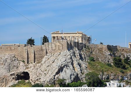 ATHENS GREECE - MAY 03: Acropolis in Athens on MAY 03 2015. Ancient Ruins of Acropolis UNESCO World Heritage Site in Athens Greece.