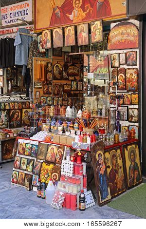 ATHENS GREECE - MAY 05: Orthodox Church Store in Athens on MAY 05 2015. Icons and Candles in Religious Shop in Downtown Athens Greece.