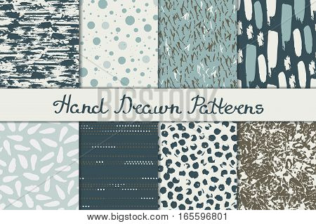 Collection of abstract seamless patterns in blue and brown colors. Ink, pen and brush. Hand drawn. Vector illustration.