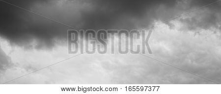 Dramatic clouds background. Clouds over horizon cloudscape storm.